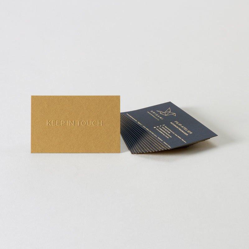 Luxe verlijmd visitekaartje met reliëfdruk en foliedruk